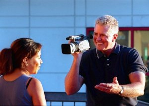 Huell Howser with Marleni Salgado. Alternative caption: Names that make us happy.