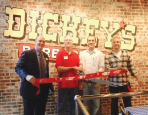 the red ribbon is proudly cut at the opening of another Dickey's BBQ