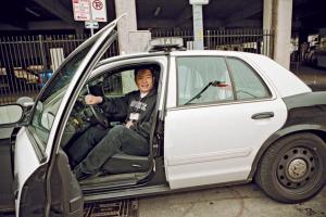 Success! Policemen let him sit in their car.