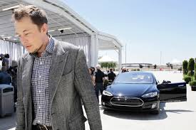Elon Musk, looking cool in front of the friggin' car he made.