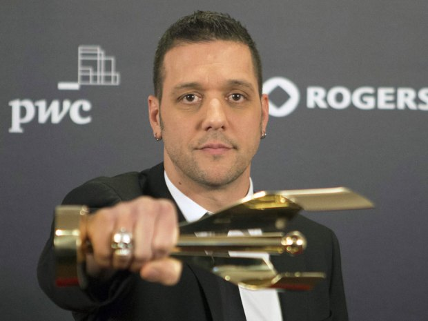 Strombo looking at his sideways award