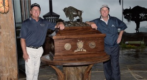 Fred Funk, left, and Jeff Sluman won this baby as a team. The saw must be in the background. (Getty Images)