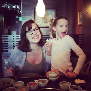 Milla & Ever, enjoying fine foods with chopsticks!
